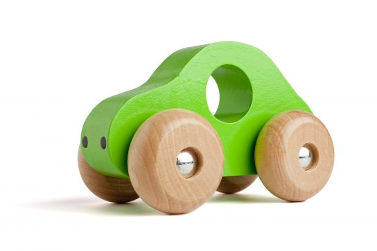 Green wooden toy car isolated on white.